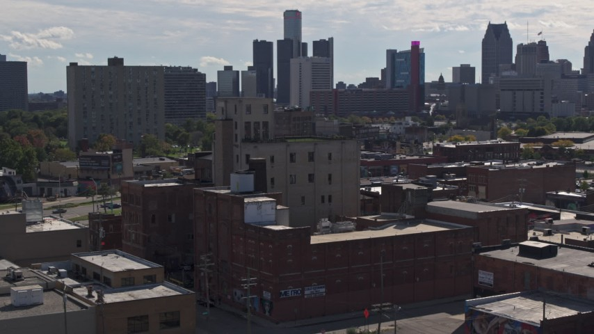 5.7K stock footage aerial video of orbiting a brick warehouse building in Detroit, Michigan Aerial Stock Footage | DX0002_194_046