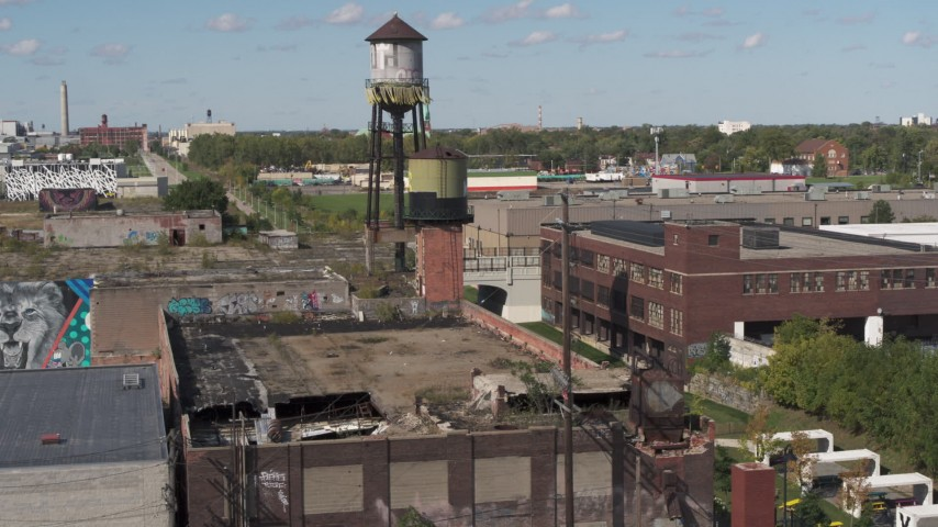 5.7K stock footage aerial video of orbiting a water tower atop an abandoned brick building in Detroit, Michigan Aerial Stock Footage | DX0002_194_048