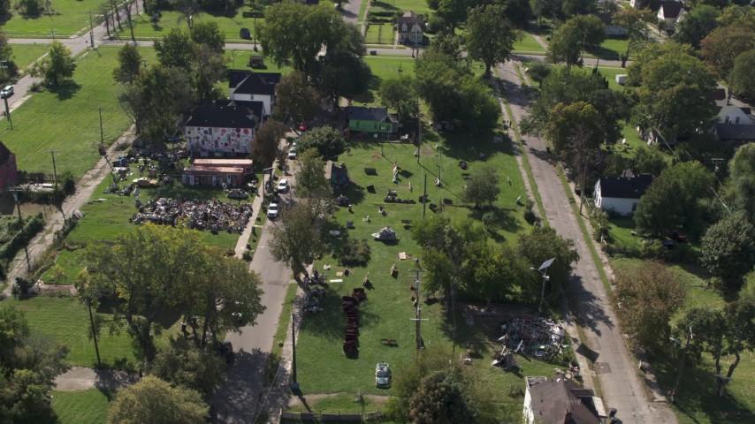 5.7K stock footage aerial video of orbiting the Heidelberg Project art display in Detroit, Michigan Aerial Stock Footage | DX0002_195_001