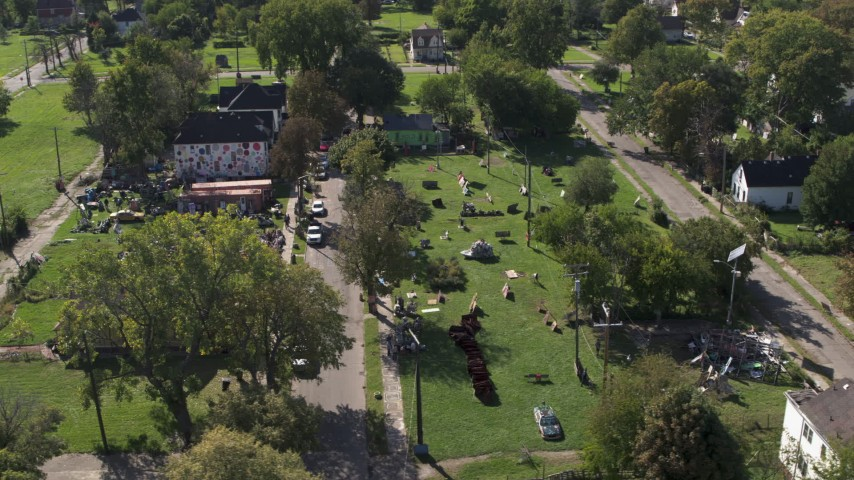 5.7K stock footage aerial video orbit and fly away from the Heidelberg Project art display in Detroit, Michigan Aerial Stock Footage | DX0002_195_003