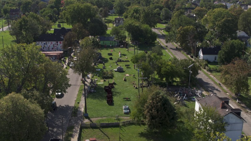 5.7K stock footage aerial video of circling the Heidelberg Project art display in Detroit, Michigan Aerial Stock Footage | DX0002_195_005