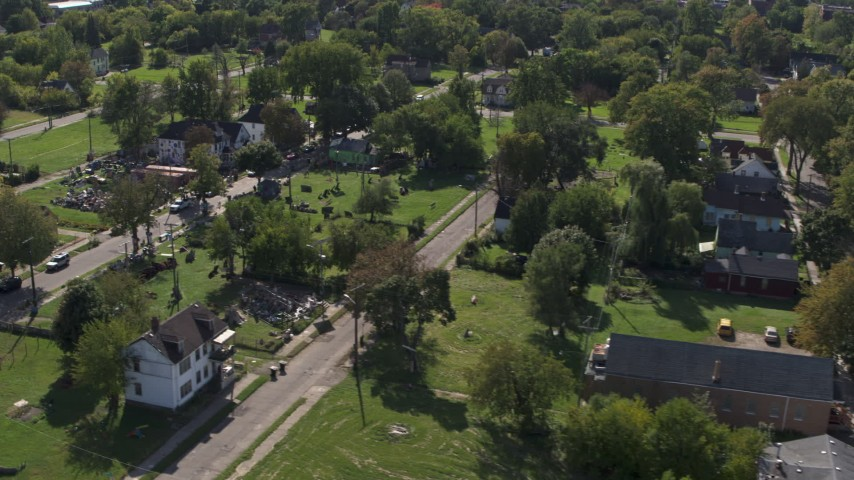 5.7K stock footage aerial video of flying by the Heidelberg Project art display and urban homes in Detroit, Michigan Aerial Stock Footage | DX0002_195_006