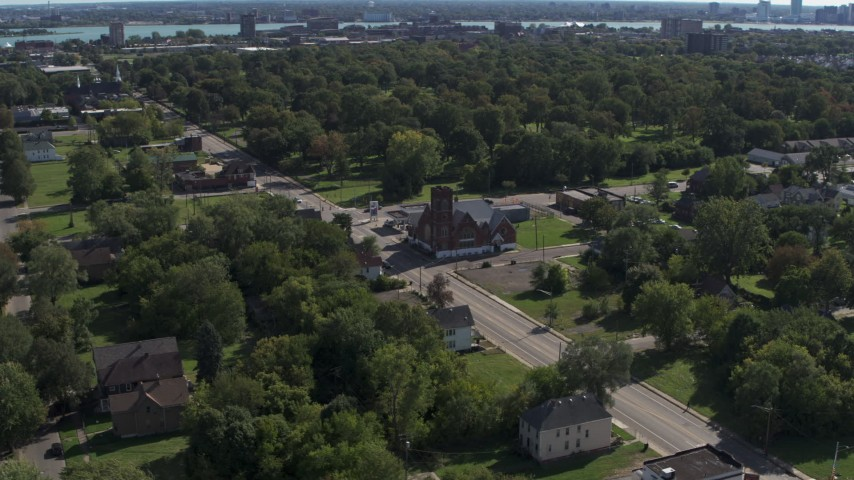 5.7K stock footage aerial video ascend over urban homes to orbit a church on Mt Elliott Street, Detroit, Michigan Aerial Stock Footage | DX0002_195_013