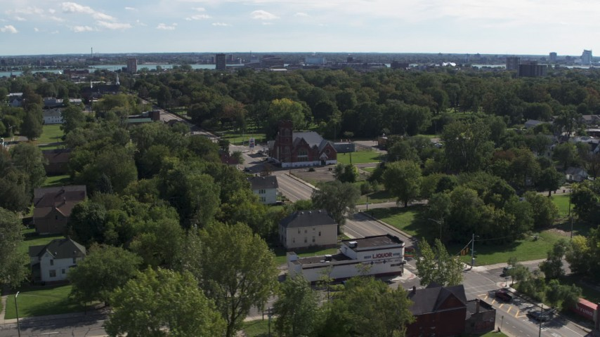 5.7K stock footage aerial video of orbiting urban homes and a church on Mt Elliott Street, Detroit, Michigan Aerial Stock Footage | DX0002_195_014