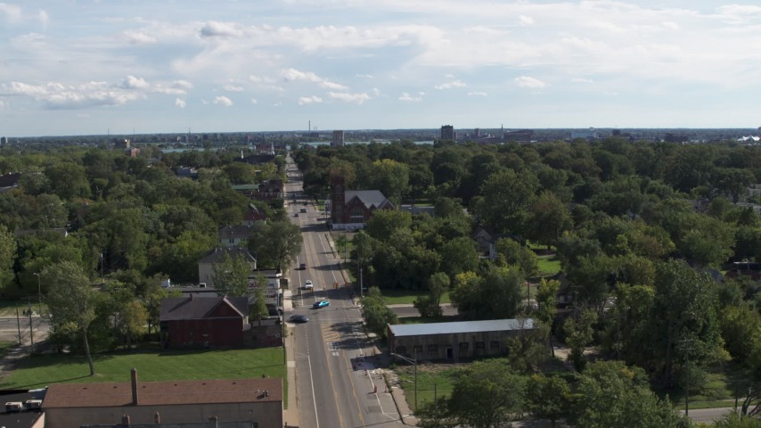 5.7K stock footage aerial video of circling urban homes and a church on Mt Elliott Street, Detroit, Michigan Aerial Stock Footage | DX0002_195_015