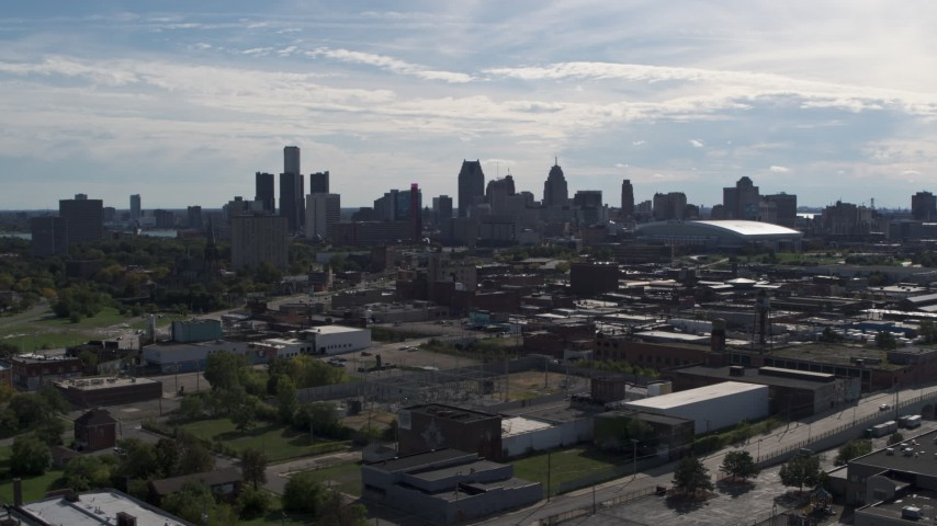 5.7K stock footage aerial video of the city's skyline seen from brick industrial buildings, Downtown Detroit, Michigan Aerial Stock Footage | DX0002_195_016