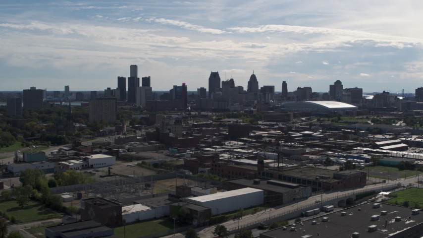 5.7K stock footage aerial video wide view of the city's skyline seen from brick industrial buildings, Downtown Detroit, Michigan Aerial Stock Footage | DX0002_195_017