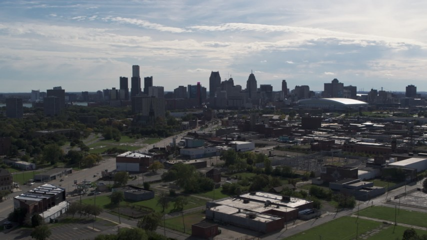 5.7K stock footage aerial video of the city's skyline, descend near brick industrial buildings, Downtown Detroit, Michigan Aerial Stock Footage | DX0002_195_018