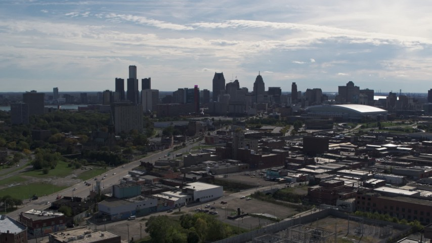 5.7K stock footage aerial video a reverse view of the city's skyline from brick industrial buildings, Downtown Detroit, Michigan Aerial Stock Footage | DX0002_195_020
