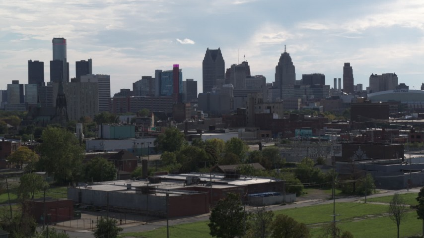 5.7K stock footage aerial video focus on the city's skyline while ascending near brick buildings, Downtown Detroit, Michigan Aerial Stock Footage | DX0002_195_025