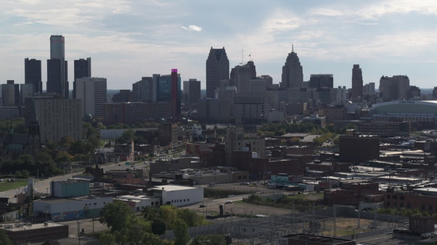 5.7K stock footage aerial video focus on the city's skyline while flying by brick buildings, Downtown Detroit, Michigan Aerial Stock Footage | DX0002_195_026