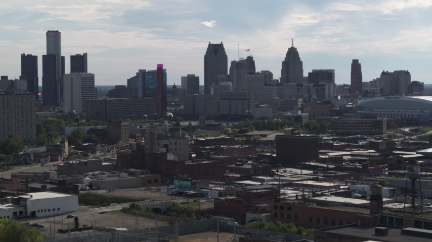 5.7K stock footage aerial video focus on the city's skyline while flying past brick buildings, Downtown Detroit, Michigan Aerial Stock Footage | DX0002_195_027