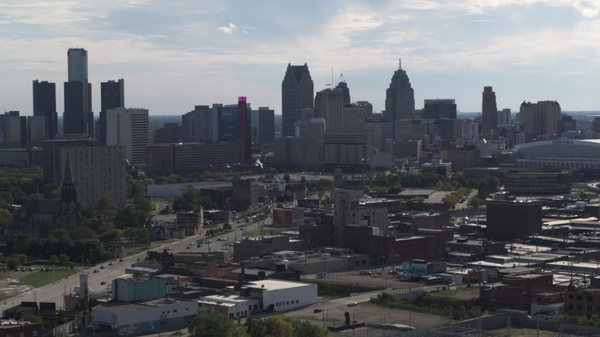 5.7K stock footage aerial video focus on the city's skyline while flying past brick buildings, Downtown Detroit, Michigan Aerial Stock Footage | DX0002_195_028
