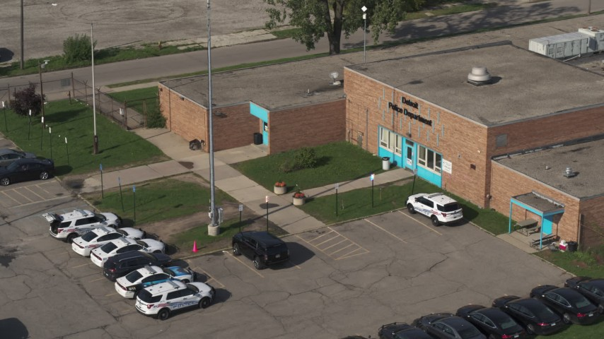 5.7K stock footage aerial video of the police station's front entrance in Detroit, Michigan Aerial Stock Footage | DX0002_195_033