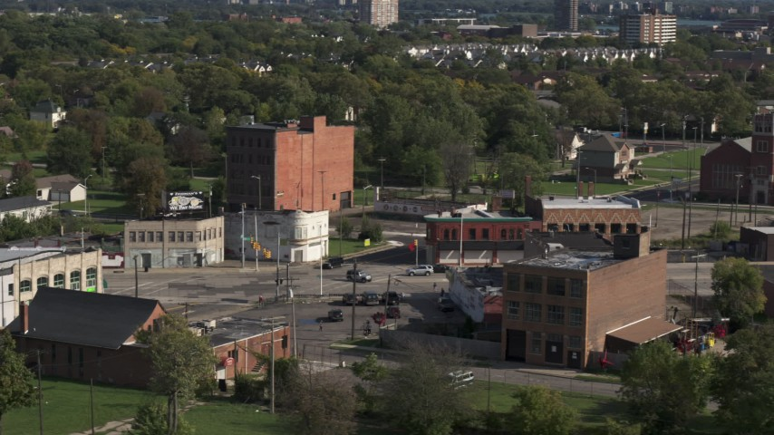 5.7K stock footage aerial video abandoned buildings by a street intersection in Detroit, Michigan Aerial Stock Footage | DX0002_195_037