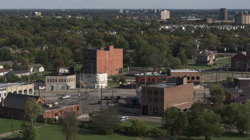 5.7K stock footage aerial video orbit a street intersection with two abandoned buildings in Detroit, Michigan Aerial Stock Footage | DX0002_195_038