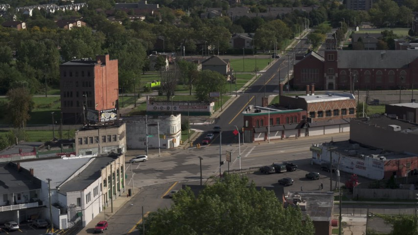 5.7K stock footage aerial video orbit a street intersection with abandoned buildings and shops in Detroit, Michigan Aerial Stock Footage | DX0002_195_039