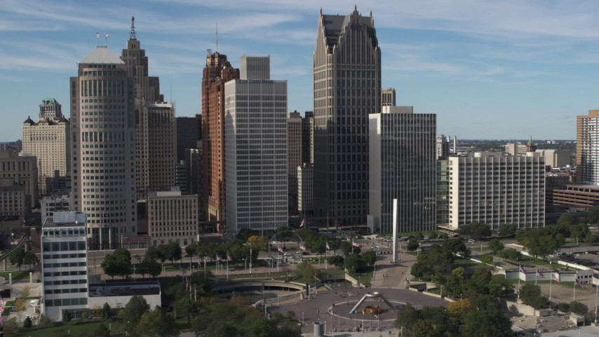 5.7K stock footage aerial video of orbiting towering skyscrapers across from Hart Plaza, Downtown Detroit, Michigan Aerial Stock Footage | DX0002_196_001