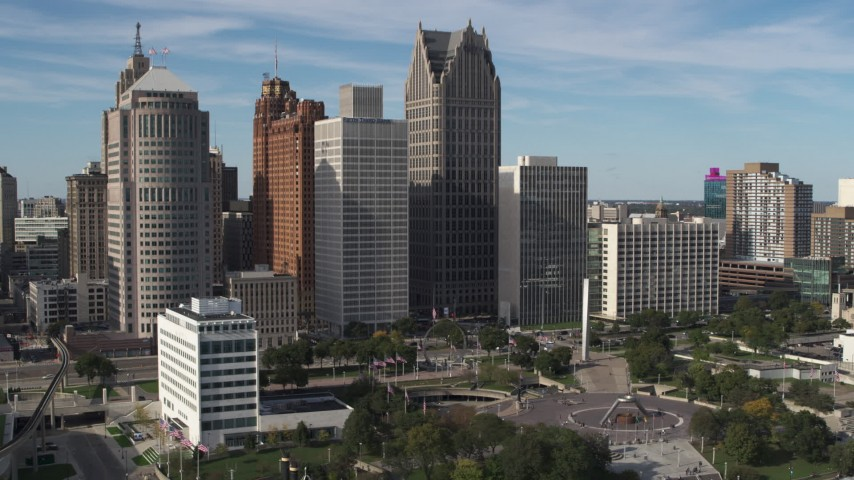 5.7K stock footage aerial video of towering skyscrapers across from Hart Plaza, Downtown Detroit, Michigan Aerial Stock Footage | DX0002_196_002