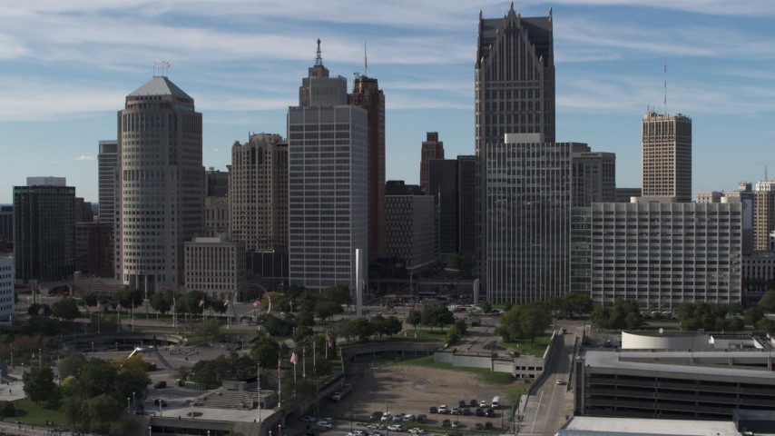 5.7K stock footage aerial video orbit and approach towering skyscrapers across from Hart Plaza, Downtown Detroit, Michigan Aerial Stock Footage | DX0002_196_004