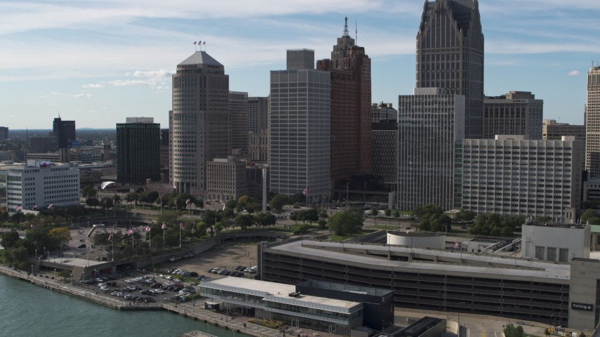 5.7K stock footage aerial video ascend away from tall skyscrapers and Hart Plaza, Downtown Detroit, Michigan Aerial Stock Footage | DX0002_196_009