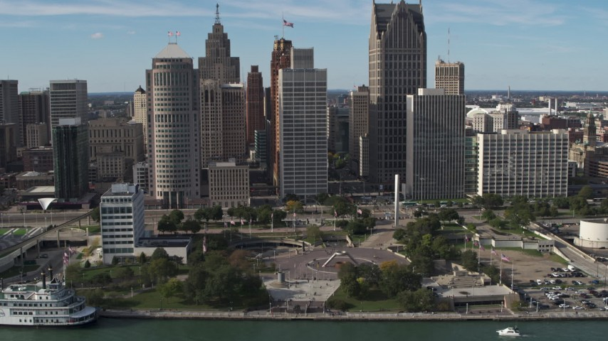 5.7K stock footage aerial video slowly orbit tall skyscrapers and Hart Plaza, Downtown Detroit, Michigan Aerial Stock Footage | DX0002_196_011
