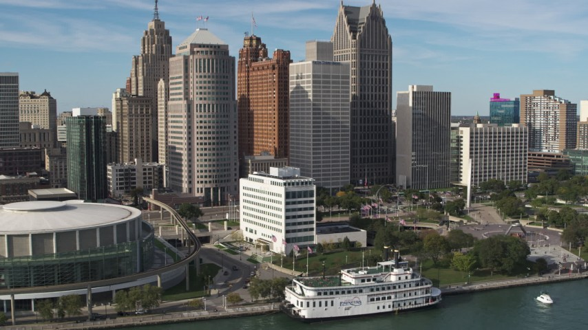 5.7K stock footage aerial video approach and orbit tall skyscrapers and Hart Plaza, Downtown Detroit, Michigan Aerial Stock Footage | DX0002_196_012