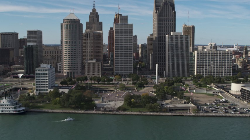 5.7K stock footage aerial video of circling tall skyscrapers behind Hart Plaza, Downtown Detroit, Michigan Aerial Stock Footage | DX0002_196_013