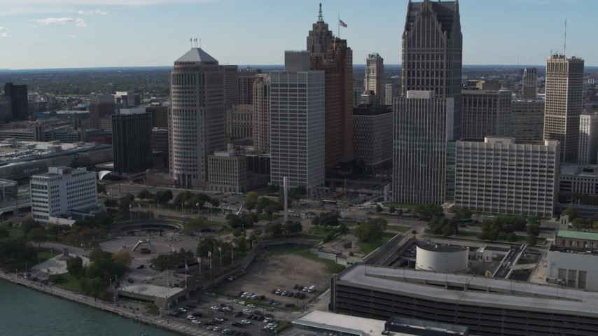 5.7K stock footage aerial video of orbiting tall city skyscrapers behind Hart Plaza, Downtown Detroit, Michigan Aerial Stock Footage | DX0002_196_014
