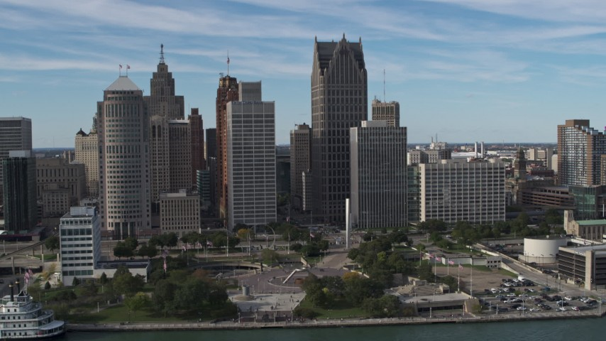 5.7K stock footage aerial video orbit of tall city skyscrapers behind Hart Plaza, Downtown Detroit, Michigan Aerial Stock Footage | DX0002_196_015