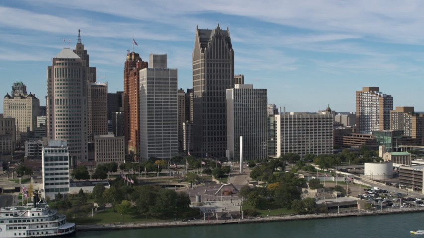 5.7K stock footage aerial video a view of tall city skyscrapers beside Hart Plaza, Downtown Detroit, Michigan Aerial Stock Footage | DX0002_196_016
