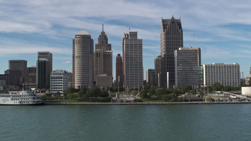 5.7K stock footage aerial video a stationary view of tall city skyscrapers beside Hart Plaza, Downtown Detroit, Michigan Aerial Stock Footage | DX0002_196_017