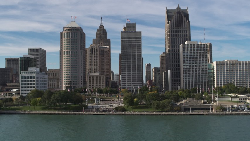 5.7K stock footage aerial video fly over river and Hart Plaza to approach tall city skyscrapers, Downtown Detroit, Michigan Aerial Stock Footage | DX0002_196_018
