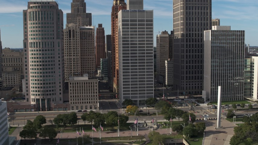 5.7K stock footage aerial video orbit and fly away from skyscrapers by Hart Plaza, Downtown Detroit, Michigan Aerial Stock Footage | DX0002_196_019