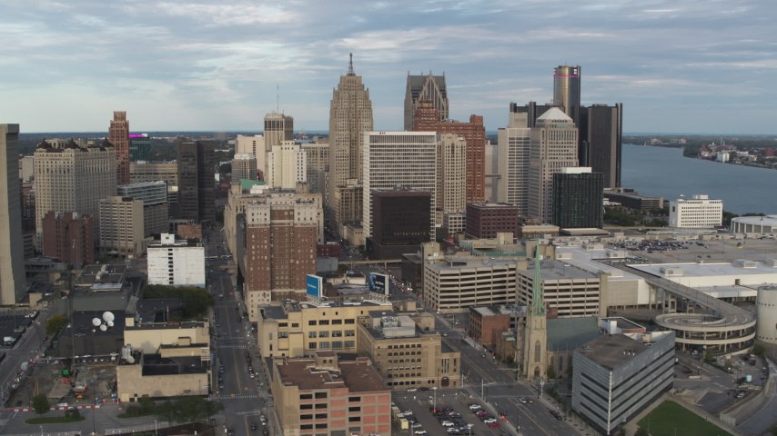 5.7K stock footage aerial video descend and orbit of a group of skyscrapers in Downtown Detroit, Michigan Aerial Stock Footage | DX0002_196_027