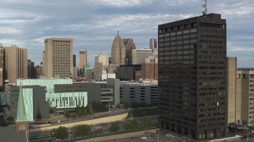 5.7K stock footage aerial video stationary view of skyscrapers between police headquarters and office tower in Downtown Detroit, Michigan Aerial Stock Footage | DX0002_196_029