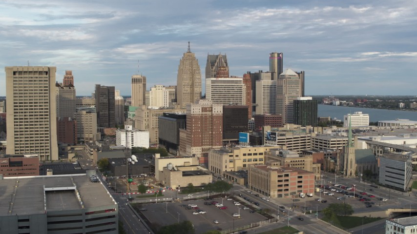 5.7K stock footage aerial video of flying by an office tower to reveal skyscrapers, Downtown Detroit, Michigan Aerial Stock Footage | DX0002_196_030