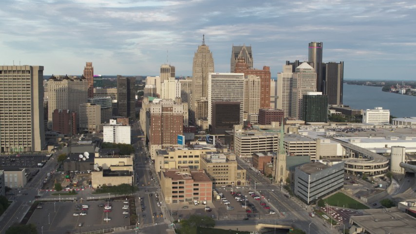 5.7K stock footage aerial video of flying away from a group of skyscrapers in Downtown Detroit, Michigan Aerial Stock Footage | DX0002_196_031