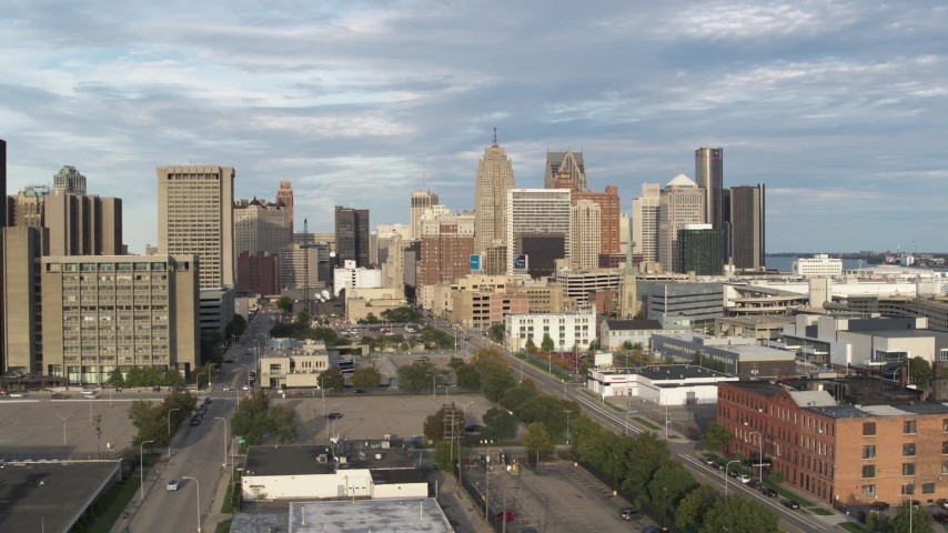 5.7K stock footage aerial video of descending while focused on a group of skyscrapers in Downtown Detroit, Michigan Aerial Stock Footage | DX0002_196_032