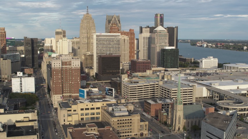 5.7K stock footage aerial video of a reverse view of a group of skyscrapers in Downtown Detroit, Michigan Aerial Stock Footage | DX0002_196_035