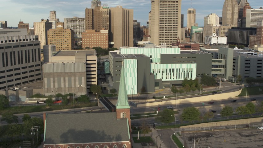 5.7K stock footage aerial video a reverse view of Detroit Public Safety Headquarters in Downtown Detroit, Michigan Aerial Stock Footage | DX0002_196_040