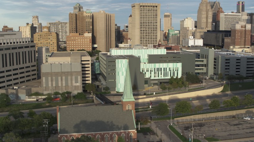 5.7K stock footage aerial video of orbiting the Detroit Public Safety Headquarters in Downtown Detroit, Michigan Aerial Stock Footage | DX0002_196_041