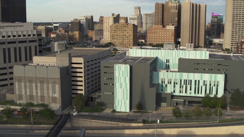 5.7K stock footage aerial video of orbiting and approaching the Detroit Public Safety Headquarters in Downtown Detroit, Michigan Aerial Stock Footage | DX0002_196_042