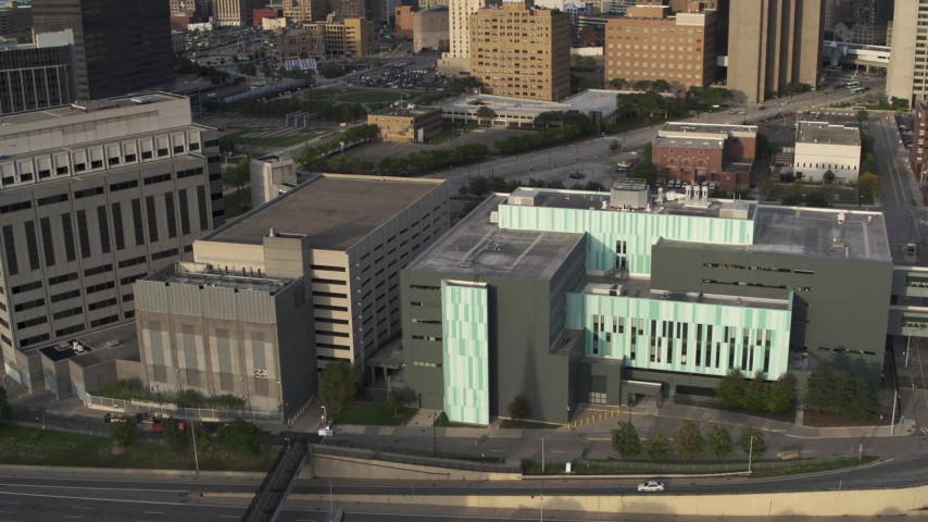 5.7K stock footage aerial video ascend while focused on the Detroit Public Safety Headquarters in Downtown Detroit, Michigan Aerial Stock Footage | DX0002_196_044