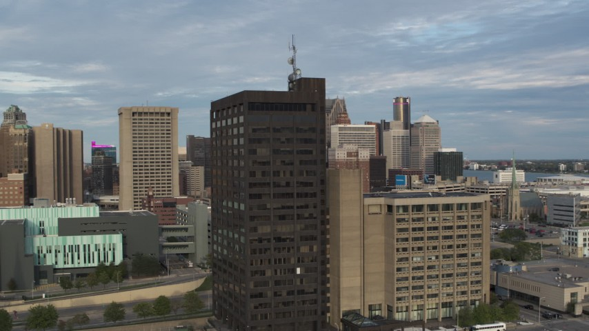 5.7K stock footage aerial video orbit the Executive Plaza Building in Downtown Detroit, Michigan Aerial Stock Footage | DX0002_196_048
