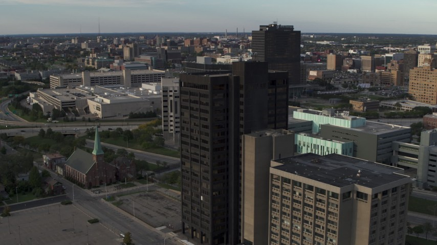 5.7K stock footage aerial video of circling the Executive Plaza Building in Downtown Detroit, Michigan Aerial Stock Footage | DX0002_196_049