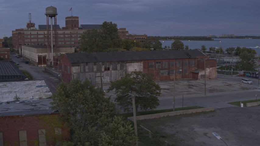 5.7K stock footage aerial video of orbiting an abandoned factory building at sunset, Detroit, Michigan Aerial Stock Footage | DX0002_197_008