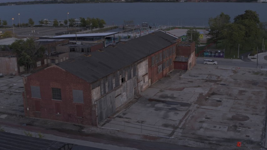 5.7K stock footage aerial video of an abandoned Northern Cranes factory building at sunset, Detroit, Michigan Aerial Stock Footage | DX0002_197_011