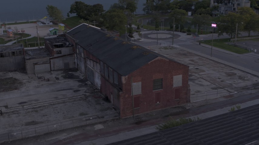 5.7K stock footage aerial video of orbiting an abandoned Northern Cranes factory building at sunset, Detroit, Michigan Aerial Stock Footage | DX0002_197_012