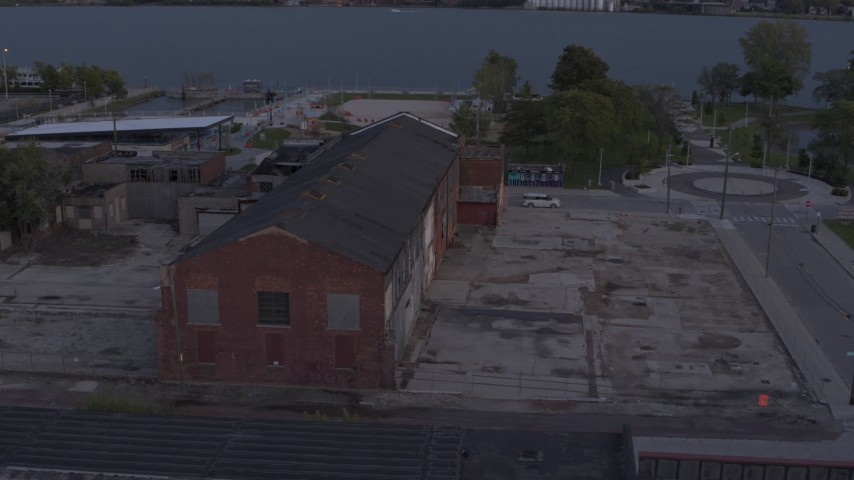 5.7K stock footage aerial video orbit an abandoned Northern Cranes factory building at sunset, Detroit, Michigan Aerial Stock Footage | DX0002_197_013